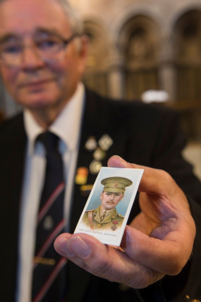 David Enyon, Ranken's grandnephew, holding a cigarette card. Copyright University of Glasgow.
