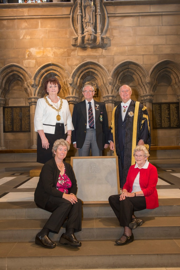 Glasgow's Lord Provost Sadie Docherty and Chancellor of the University of Glasgow Sir Kenneth Calman and the family of Harry Ranken pose with the commemorative VC stone