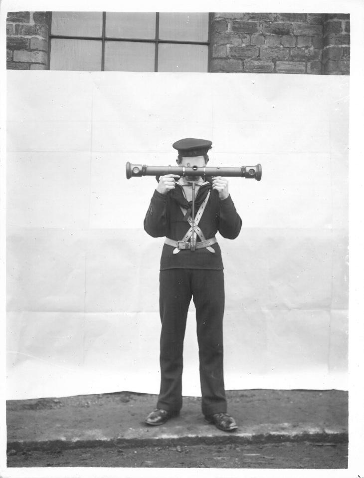 Demonstrating a rangefinder. University of Glasgow Archives Reference: UGD295/8/1/1/287